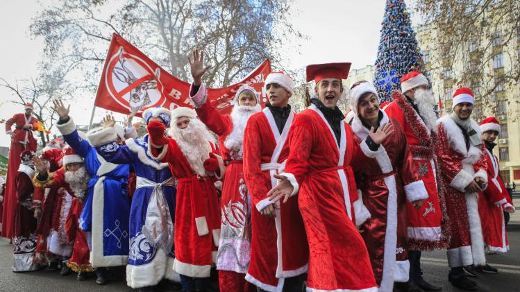 Revellers dressed in Santa outfits attend a parade in the southern Russia's city of Krasnodar