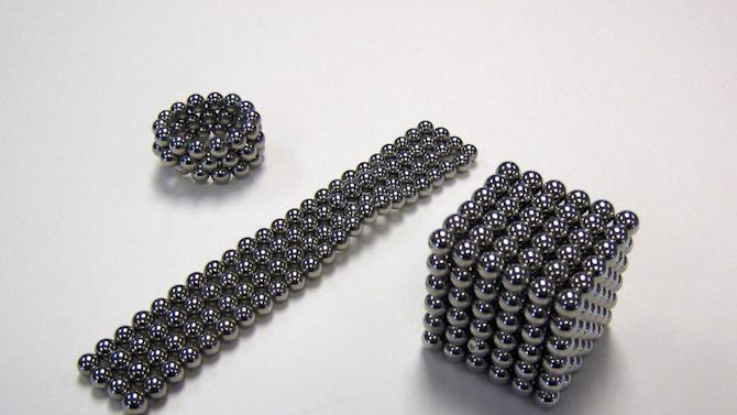 This image released by the Consumer Product Safety Commission shows Buckyballs, a high-powered desktop magnetic toy for adults. In an unusual move, the Consumer Product Safety Commission filed an administrative complaint Wednesday against New York-based Maxfield and Oberton, the manufacturer of Buckyballs. The desktop toys have small but very powerful magnets that are strong enough to mold into different shapes. Some young children are swallowing the tiny magnets and getting hurt, and teens also have ingested the magnetic balls after trying to mimic tongue piercings. (AP Photo/CPSC)