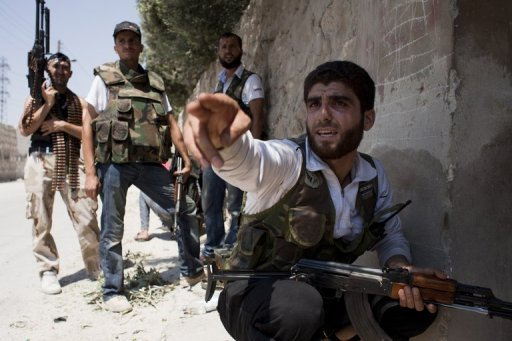 Syrian opposition fighters battle government forces in the Karm al-Tarab neighborhood of Aleppo on August 17. The conflict in Syria is a struggle between the United States and Iran whose outcome will decide whether the Middle East follows the path of an Iran-inspired Islamic movement or US influence, a top Iranian official said on Saturday