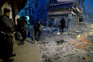 "Brazilian policemen deploy at Jacarezinho shantytown, known as ""Crackland"", in Rio de Janeiro, Brazil. Brazilian marines and paramilitary police stormed the shantytowns Sunday, as the city cleans up ahead of the 2014 World Cup and the 2016 Olympic Games"