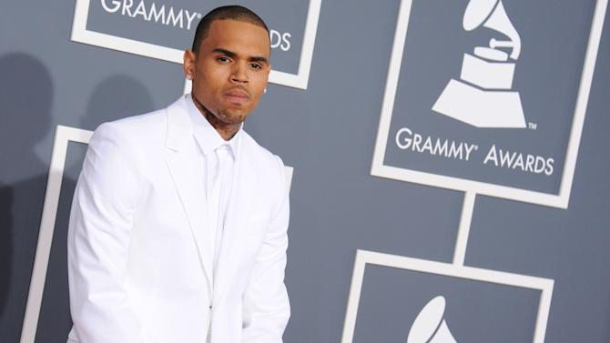 FILE - In this Feb. 10, 2013 file photo, Chris Brown arrives at the 55th annual Grammy Awards, in Los Angeles. Brown has had his probation reinstated and has been given a new sentence to stand 1,000 hours performing community labor. A prosecutor agreed Friday, Aug. 16, 2013, to withdraw a request to rescind Brown's probation after he was involved in an alleged hit-and-run accident. (Photo by Jordan Strauss/Invision/AP, File)