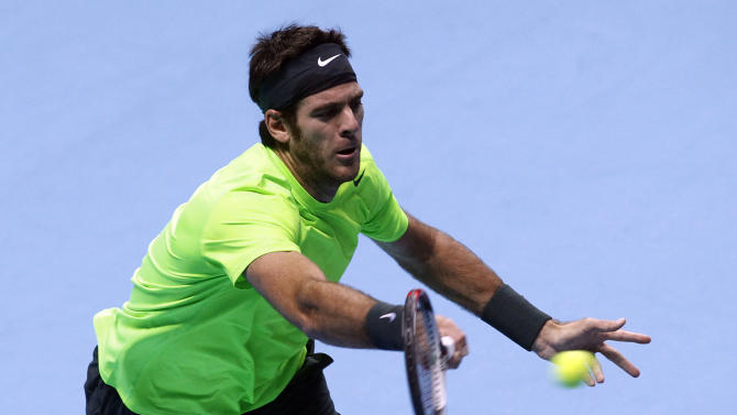 Juan Martin Del Potro of Argentina plays a return to Novak Djokovic of Serbia, during their ATP World Tour Finals singles semifinal tennis match at the O2 Arena in London, Sunday, Nov. 11, 2012. (AP Photo/Sang Tan)