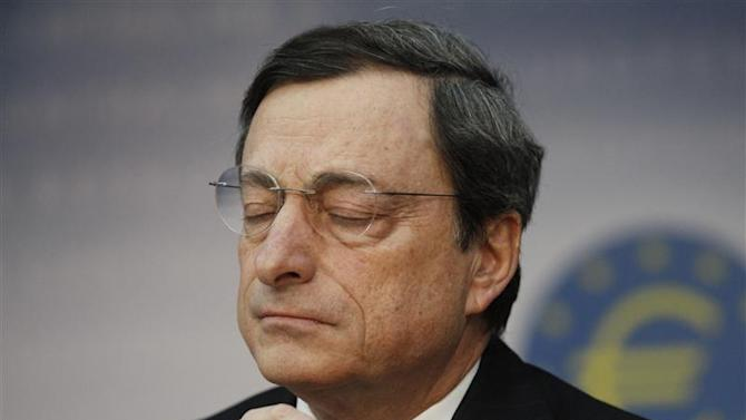 ECB President Draghi reacts during the monthly news conference in Frankfurt