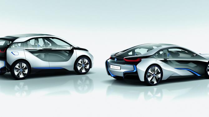 In this image provided by BMW, form left, BMW i3 Concept and BMW i8 Concept are shown.    BMW is showing off a pair of new hybrid and electric concept cars expected to reach dealer showrooms in the next few years.  The German automaker gave journalists in New York a sneak peak of its i3 city car and i8 sports car Wednesday, Nov. 9, 2011. The cars will officially debut at the Los Angeles auto show next week.   Both feature carbon fiber construction, which reduces the weight of the vehicle and the size of its frame. It also allows BMW to construct much of the exteriors out of tinted glass instead of metal, giving them a see-through quality. (AP Photo/BMW)