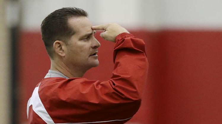Nebraska offensive coordinator/quarterback coach Tim Beck signals a play on the first day of spring NCAA college spring football practice in Lincoln, Neb., Saturday, March 8, 2014