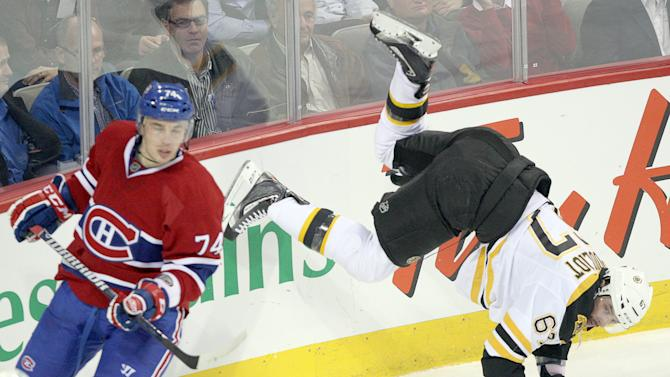 Boston Bruins left wing Benoit Pouliot (67) is upended by Montreal Canadiens defenseman Alexei Emelin (74) during second period National Hockey League action Monday, Nov.  21, 2011 in Montreal. (AP Photo/ The Canadian Press, Ryan Remiorz)