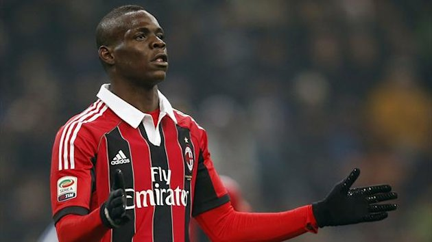 AC Milan&#39;s Mario Balotelli reacts after missing a goal opportunity against Inter Milan during their Italian Serie A soccer match at the San Siro Stadium in Milan February 24, 2013.