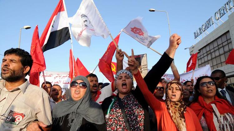 Tunisians chant slogans as they march outside the National Assembly in Tunis on September 7, 2013 to mark the 40th day since the assassination of opposition politician Mohamed Brahmi