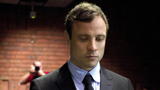 FILE - In this Monday, Aug. 19, 2013 file photo, double-amputee Olympian Oscar Pistorius appears at the magistrates court to be indicted on charges of murder and illegal possession of ammunition for the shooting death of his girlfriend on Valentine's Day in Pretoria, South Africa. A South Africa judge ruled Tuesday that television stations can broadcast parts of Oscar Pistorius' murder trial live, but with restrictions on witness testimonies. (AP Photo/Themba Hadebe, File)