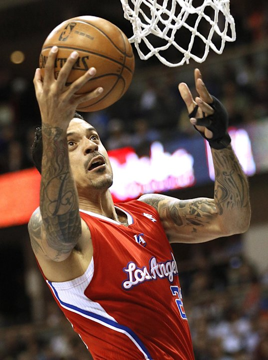 Los Angeles Clippers' Barnes goes to the hoop past the Denver Nuggets in their NBA basketball game in Denver