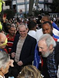This handout photo from AIN taken February 3, 2013 shows Fidel Castro (bottom R) speaking to Cubans at a polling station in Havana. The ailing revolutionary leader made a surprise appearance in Havana to vote in parliamentary polls, expressing confidence in the revolution despite a decades-long US trade embargo.