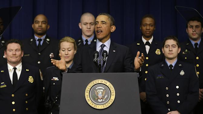 President Barack Obama, accompanied by emergency responders, a group of workers the White House says could be affected if state and local governments lose federal money as a result of budget cuts, gestures as he speaks in the South Court Auditorium in the Eisenhower Executive Office building on the White House complex in Washington, Tuesday, Feb. 19, 2013. (AP Photo/Charles Dharapak)
