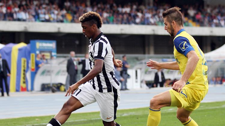 Juventus' Kingsley Coman, left, is followed by Chievo defender Bostjan Cesar during a Serie A soccer match at the Bentegodi stadium in Verona, Italy, Saturday, Aug. 30, 2014. (AP Photo/Felice Calabro')