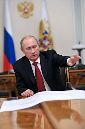 Russian President Vladimir Putin gestures during a meeting with Russian gas monopoly Gazprom head Alexei Miller in the Novo-Ogaryovo, near Moscow, Monday, Oct. 29, 2012. (AP Photo/RIA-Novosti, Alexei Nikolsky, Presidential Press Service)