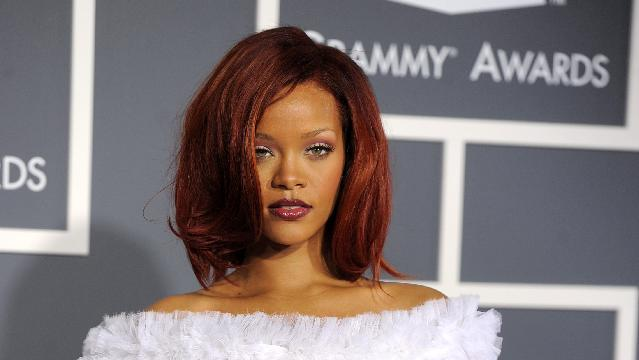 """FILE - This Feb. 13, 2011 file photo shows Rihanna at the 53rd annual Grammy Awards in Los Angeles. CBS has issued a memo to Grammy Awards attendees against baring too much skin at the ceremony Sunday. The network requests that """"buttocks and female breasts are adequately covered"""" for the televised award show. The memo sent out Wednesday, Feb. 6, 2013, also warned against """"see-through clothing,"""" exposure of """"the genital region"""" and said that """"thong type costumes are problematic."""" (AP Photo/Chris Pizzello, file)"""