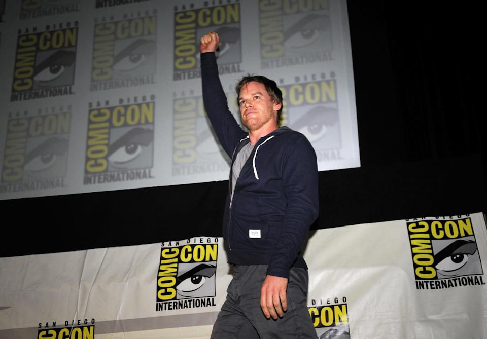 "Actor Michael C. Hall pumps his fist as he walks onto stage start of the ""Dexter"" panel on Day 2 of the 2013 Comic-Con International Convention on Thursday, July 18, 2013 in San Diego. (Photo by Denis Poroy/Invision/AP)"