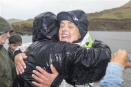 British adventurer Sarah Outen celebrates as she arrives in Adak in the Aleutian Islands September 23, 2013 to become the first person to ever row solo from Japan to Alaska - a distance of 3,750 nautical miles. REUTERS/James Sebright/Handout via Reuters