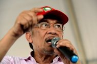 Malaysian opposition leader Anwar Ibrahim speaks at an election rally in Putrajaya on May 1, 2013. Anwar said only fraud can stop his Malaysian opposition from scoring a historic election win as the rival sides launched a last-ditch campaign blitz Saturday on the eve of a tense vote