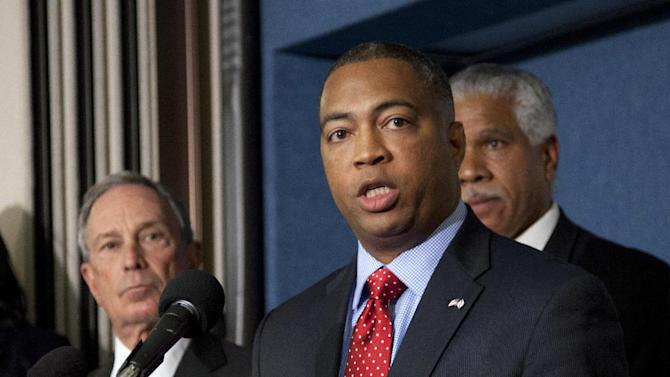 """Incoming Florida Senate Minority Leader Chris Smith, center, accompanied by New York City Mayor Michael Bloomberg, left, and NAACP Washington Bureau Director and Senior Vice President for Advocacy Hilary Shelton, gestures during a news conference at the National Press Club in Washington, Wednesday, April 11, 2012, to announce a nationwide campaign to reform or repeal Florida-style """"Shoot First"""" laws that have passed in states across the country.   (AP Photo Manuel Balce Ceneta)"""