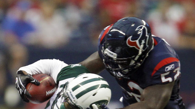 Houston Texans linebacker Xavier Adibi (52) brings down New York Jets wide receiver Jeremy Kerley (11) during the first quarter of an NFL preseason football game Monday, Aug. 15, 2011, in Houston. (AP Photo/Eric Gay)
