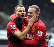 Ryan Giggs (L) celebrates scoring Manchester United&#39;s second goal against QPR with Wayne Rooney, on February 23, 2013. The evergreen Giggs sealed victory in the 80th minute, ghosting onto Nani&#39;s through ball and whipping a low shot past the exposed Cesar