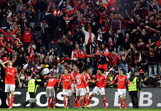 Benfica's Ezequiel Garay, from Argentina, 2nd right, celebrates after scoring their second goal during their Portuguese league soccer match with Porto Sunday, Jan. 12 2014, at Benfica's Luz st