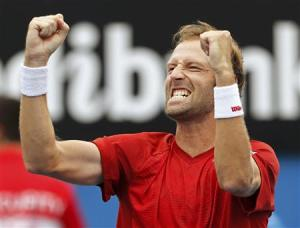Stephane Robert of France celebrates defeating Martin Klizan of Slovakia during their men's singles match at the Australian Open 2014 tennis tournament in Melbourne