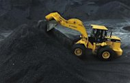 An excavator transfers coal at an opencast coal mine in Fuxin, Liaoning province May 30, 2012. REUTERS/Stringer