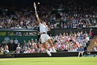 Switzerland's Roger Federer jumps to play a shot during his men's singles final match against Britain's Andy Murray on day 13 of the 2012 Wimbledon Championships tennis tournament at the All England Tennis Club in Wimbledon, southwest London. Federer won a record-equalling seventh Wimbledon title and 17th Grand Slam crown