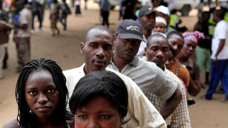 Angolans queue at a voting station in Kicolo, Luanda, Angola to cast their ballots Friday, Aug. 31, 2012. Victory for the Popular Movement for the Liberation of Angola, (MPLA) would give Angola's ruler for 33 years , President Jose Eduardo dos Santos, another five-year term. (AP Photo)