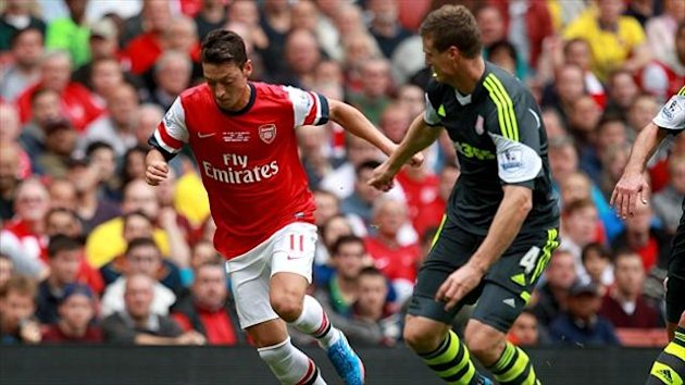 Mesut Ozil, left, impressed on his home debut for Arsenal
