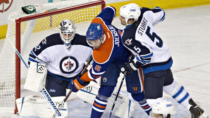 Acton sends Oilers past Jets 2-1
