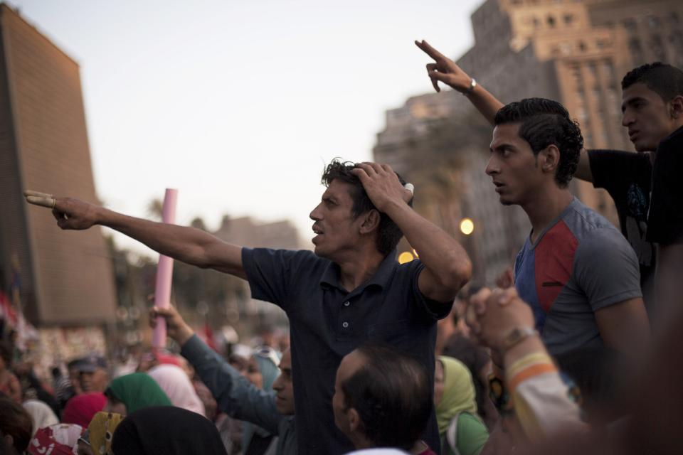 Men chant slogans against Egyptian President Mohammed Morsi during a demonstration supporting in Tahrir Square in Cairo, Egypt, Wednesday, June 26, 2013.(AP Photo/Manu Brabo)