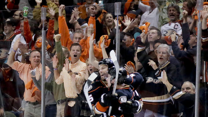 Anaheim Ducks defenseman Sami Vatanen, right, celebrates after scoring with Ryan Getzlaf during the first period in Game 5 of the Western Conference final of the NHL hockey Stanley Cup playoffs against the Chicago Blackhawks in Anaheim, Calif., on Monday, May 25, 2015. (AP Photo/Alex Gallardo)