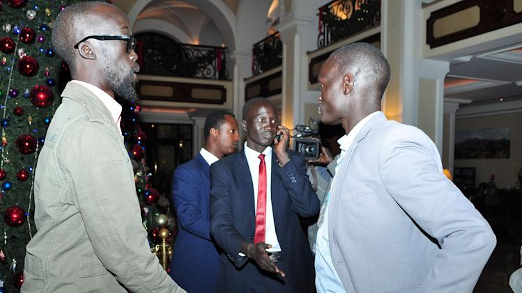 Grang Demebiar, left, the son of late Sudanese politician John Garang, who is in the group supporting ousted Vice President Riek Machar, as Grang Demebiar arrives with unidentified delegates in Addis Ababa, Ethiopia, Thursday, Jan. 2, 2014, to start peace talks. African mediators met representatives of the rival sides representing President Salva Kiir and ousted Vice President Riek Machar, briefing them separately ahead of the official start of direct talks. South Sudan has been plagued by ethnic violence underscoring the challenge facing African mediators and the rival delegation sides. (AP Photo/Elais Asmare)