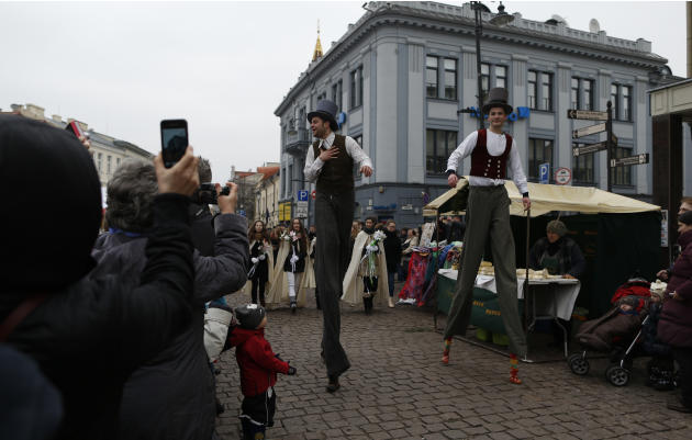 People watch a circus performance during the traditional Kaziukas fair, a large annual folk arts and craft fair in Vilnius, Lithuania, Saturday, March 8, 2014. The festival honors St. Casimir, the pat