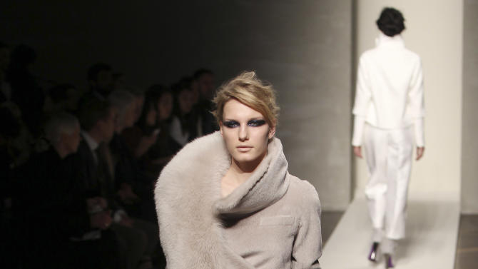 A model wears a creation part of the Gianfranco Ferre' women's Fall-Winter 2012-13 fashion collection, during the fashion week in Milan, Italy, Monday, Feb. 27, 2012. (AP Photo/Antonio Calanni)