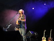US Musician Jason Mraz performs onstage during an acoustic concert celebrating the tenth anniversary of the independently released &quot;Live And Acoustic 2001&quot; in Nusa Dua on Indonesia&#39;s resort island of Bali in 2011. Faced with stubbornly feeble economies back home, more Western music acts are being lured to play in Asia to boost their profiles in a region where disposable incomes are growing