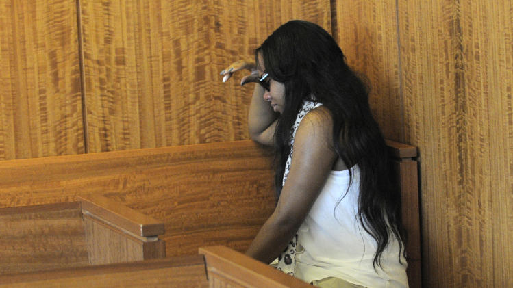 Shayanna Jenkins, fiancee of former New England Patriots football player Aaron Hernandez, weeps in the courtroom after a bail hearing for Hernandez in Fall River Superior Court Thursday, June 27, 2013, in Fall River, Mass. Hernandez, charged with murdering Odin Lloyd, a 27-year-old semi-pro football player, was denied bail. (AP Photo/Boston Herald, Ted Fitzgerald, Pool)