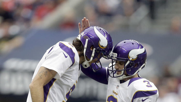 Minnesota Vikings' Blair Walsh (3) is congratulated by Chris Kluwe (5) after kicking a 56-yard field goal against the Houston Texans during the second quarter of an NFL football game Sunday, Dec. 23, 2012, in Houston. (AP Photo/Patric Schneider)