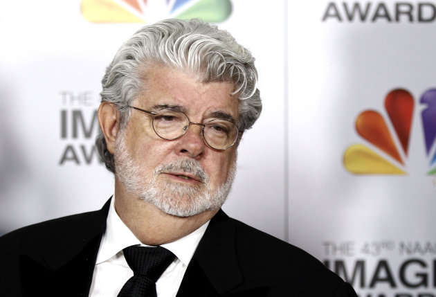 FILE - In this Feb. 17, 2012 file photo, George Lucas arrives at the 43rd NAACP Image Awards in Los Angeles. A decade after George Lucas said &quot;Star Wars&quot; was finished on the big screen, a new trilogy is destined for theaters after The Walt Disney Co. announced Tuesday, Oct. 30, 2012, that it was buying Lucasfilm Ltd. for $4.05 billion. (AP Photo/Matt Sayles File)