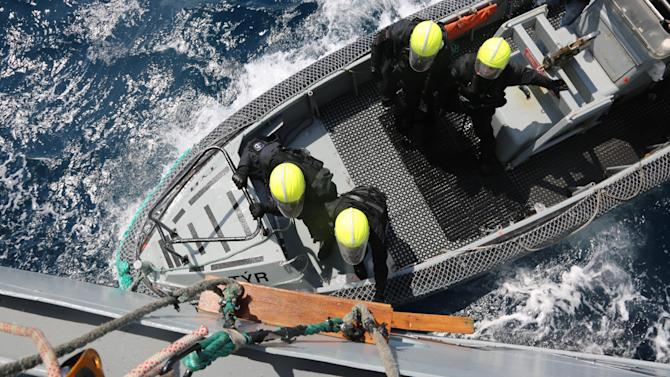 A rescue unit approaches the Icelandic Coast Guard vessel Tyr deployed by Frontex during a drill off the Sicilian coast in the Mediterranean Sea, Sunday, April 26, 2015. EU leaders on Thursday, April 23, 2015 pledged to double the size of Frontex's Triton mission and triple its budget but refused to allow it to do active search and rescue work. In the most recent incident documented by Frontex, the Icelandic Coast Guard vessel Tyr with 342 rescued migrants aboard was called by an Italian tugboat to help rescue another 250 migrants from another boat. Just after they were saved, a speedboat with armed men firing shots into the air turned up and took away the empty migrant vessel, Frontex said in a statement. (AP Photo/Francesco Malavolta)