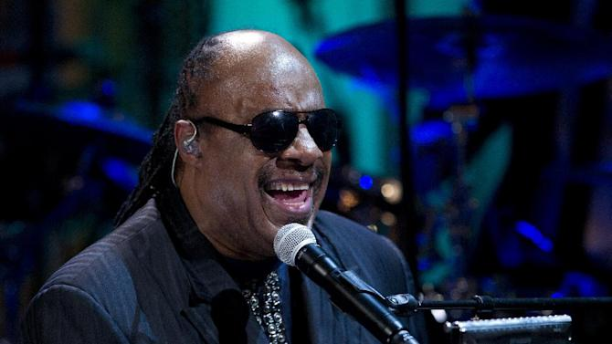 """FILE - In a Wednesday, May 9, 2012 file photo, Stevie Wonder performs during the """"In Performance at the White House"""" in the East Room of the White House in Washington, honoring songwriters Burt Bacharach and Hal David, recipients of the 2012 Library of Congress Gershwin Prize for Popular Song. Kelly Clarkson and fun. are just two of the acts who will perform during the upcoming inaugural festivities, which also includes Beyonce, James Taylor, Stevie Wonder, Katy Perry and dozens of others.  (AP Photo/Carolyn Kaster, File)"""