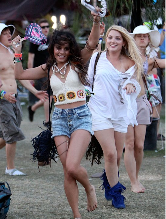 Celebrities at festivals photos: Vanessa Hudgens lived the festival vibe to the extreme rocking bare feet, beads, fringing cut=off shorts and a tambourine. Go hippy Hudgens!