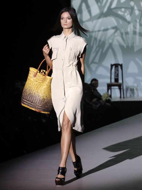 A model displays a creations by Khavaarapieva during the Volvo Fashion Week in Moscow, Russia, Saturday, Oct. 29, 2011. (AP Photo/Misha Japaridze)