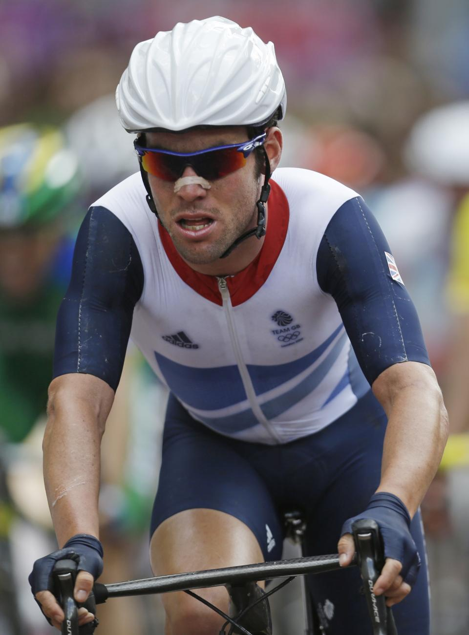 Britain's Mark Cavendish pedals during the Men's Road Cycling race at the 2012 Summer Olympics, Saturday, July 28, 2012, in London. (AP Photo/Sergey Ponomarev)