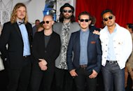 The group The Temper Trap arrive for the Australian music industry Aria Awards in Sydney, Thursday, Nov. 29, 2012. (AP Photo/Rick Rycroft)