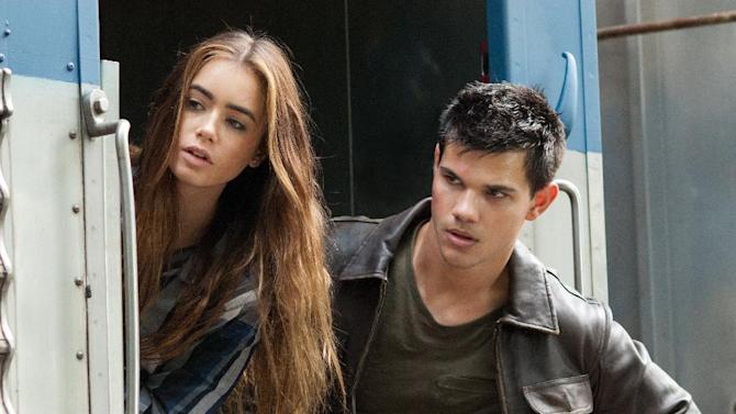 """FILE - In this undated publicity film image released by Lionsgate, Taylor Lautner, right, and Lily Collins are shown in a scene from """"Abduction."""" (AP Photo/Lionsgate, Bruce Talamon, File)"""