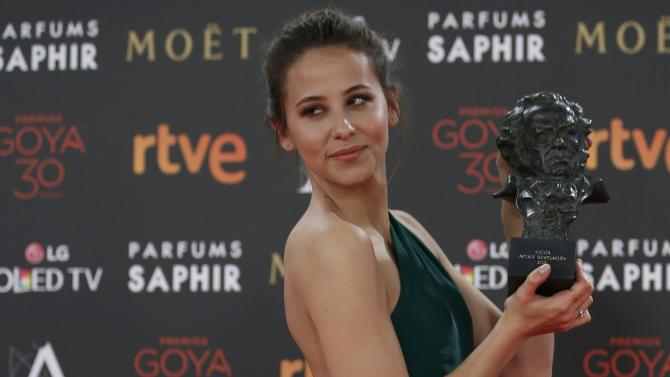 Escolar, who won the Best New Actress award, holds the trohpy during the Spanish Film Academy's Goya Awards ceremony in Madrid