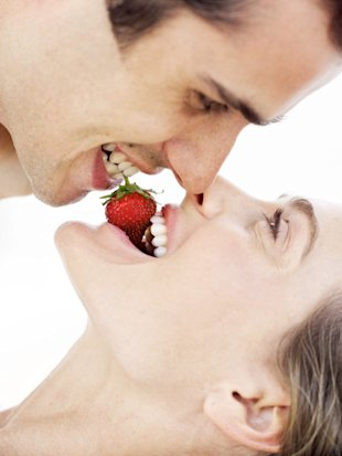 couple sharing a strawberry